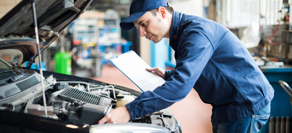 Mechanic doing a service and checking a vehicle - Car Servicing Basford, Nottingham
